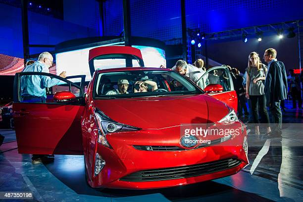Attendees look at the Toyota Motor Corp 2016 Prius hybrid vehicle after being unveiled in Las Vegas Nevada US on Tuesday Sept 8 2015 Toyota revealed...