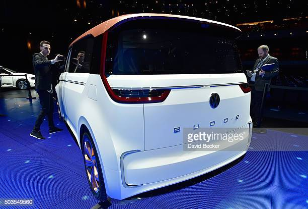 Attendees look at Volkswagen's BUDDe a long distance electric vehicle displayed during a press event at CES 2016 at The Chelsea at The Cosmopolitan...