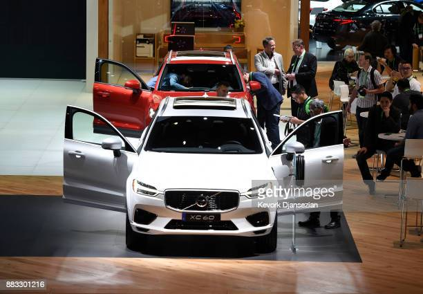 Attendees look at Volvo SUVs during the auto trade show AutoMobility LA at the Los Angeles Convention Center November 30 in Los Angeles California