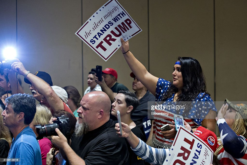 Attendees look on as Donald Trump, president and chief executive of Trump Organization Inc. and 2016 Republican presidential candidate, not pictured, greets audience members during a town hall event at the Tampa Convention Center in Tampa, Florida, U.S., on Monday, March 14, 2016. As protesters shadow campaign appearances by Trump, the billionaire has shifted a planned Monday-night rally in south Florida to Ohio, where polls show Governor John Kasich may be pulling ahead days before the states primary election. Photographer: Andrew Harrer/Bloomberg via Getty Images