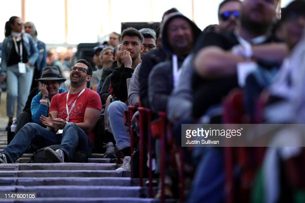 Attendees look on as Google CEO Sundar Pichai delivers the keynote address at the 2019 Google I/O conference at Shoreline Amphitheatre on May 07 2019...