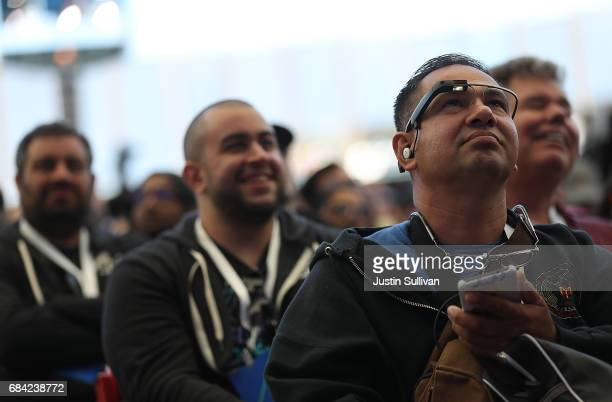 Attendees look on as Google CEO Sundar Pichai delivers the keynote address at the Google I/O 2017 Conference at Shoreline Amphitheater on May 17 2017...