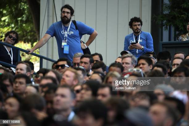 Attendees look on as Google CEO Sundar Pichai delivers the keynote address at the Google I/O 2018 Conference at Shoreline Amphitheater on May 8 2018...