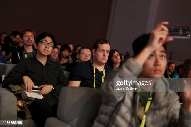 Attendees look on as Google vice president and general manager Phil Harrison speaks during the GDC Game Developers Conference on March 19 2019 in San...