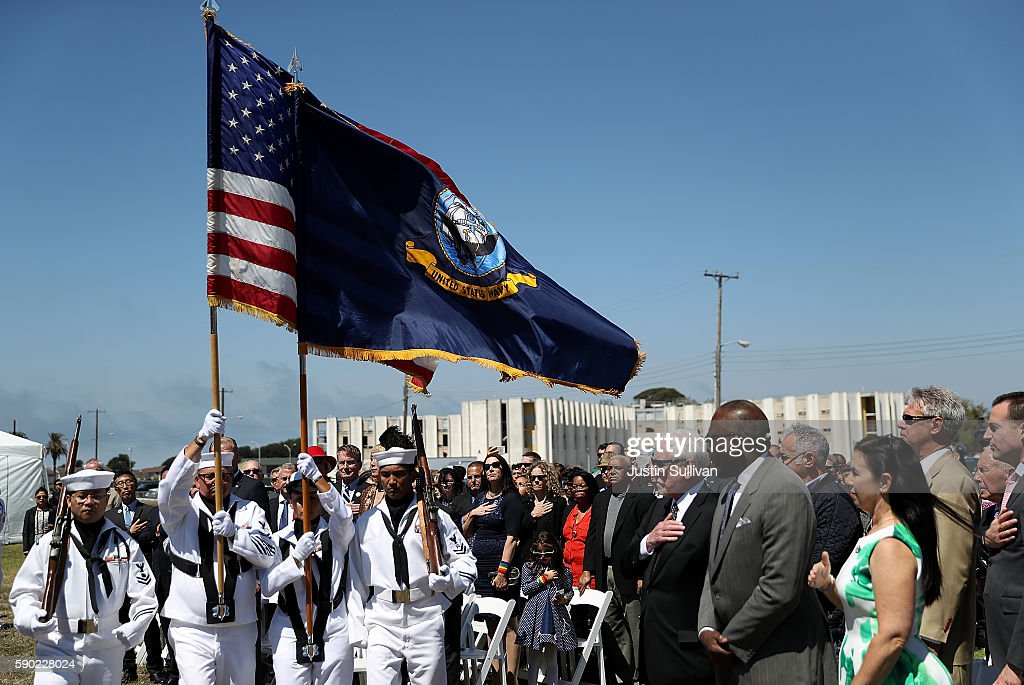 Attendees look on as the an honor guard presents the colors during a ship naming ceremony for the new USNS Harvey Milk on August 16, 2016 in San Francisco, California. U.S. Navy officials announced plans to name a new replenishment oiler ship after slain civil rights leader Harvey Milk. Six new ships in the class with be named after civil and human rights leaders.