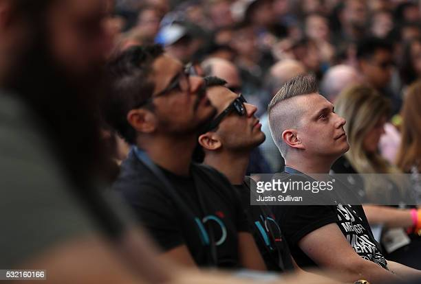 Attendees look on during Google I/O 2016 at Shoreline Amphitheatre on May 19 2016 in Mountain View California Google CEO Sundar Pichai delivered the...