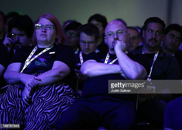 Attendees look on during the opening keynote at the Google I/O developers conference at the Moscone Center on May 15 2013 in San Francisco California...