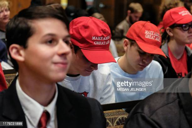 Attendees look on during Turning Point USA Culture War event at the Ohio State University in Columbus Ohio on October 29 2019 The organizations...