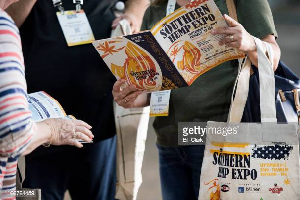 Attendees look over the program as they arrive for the Southern Hemp Expo at the Williamson County Agricultural Exposition Park in Franklin TN on...
