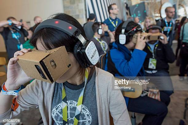 Attendees look through Google Cardboard VR viewers during the Google I/O Annual Developers Conference in San Francisco California US on Thursday May...