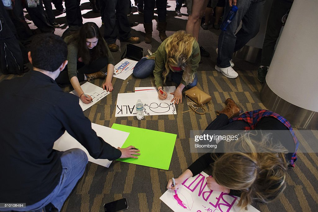 Attendees make posters at a campaign event for Senator Bernie Sanders, an independent from Vermont and 2016 Democratic presidential candidate, at the Colorado Convention Center in Denver, Colorado, U.S., on Saturday, Feb. 13, 2016. In the first Democratic debate on Thursday since her crushing defeat in New Hampshire, Hillary Clinton tried a new approach to win back wavering supporters, capturing Bernie Sanders anger without looking angry. Photographer: Matthew Staver/Bloomberg via Getty Images