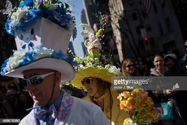 Attendees make their way along Fifth Avenue during the annual Easter Parade April 5 2015 in New York City The parade attracts hundreds of...