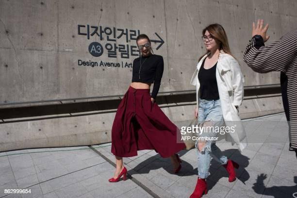 Attendees make their way between shows during Seoul Fashion Week at Dongdaemun Design Plaza in Seoul on October 19 2017 For Seoul's flamboyant...
