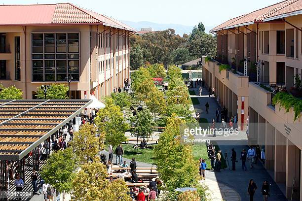 Attendees mingle during the the grand opening of the Knight Management Center at Standford Graduate School of Business in Palo Alto, California,...