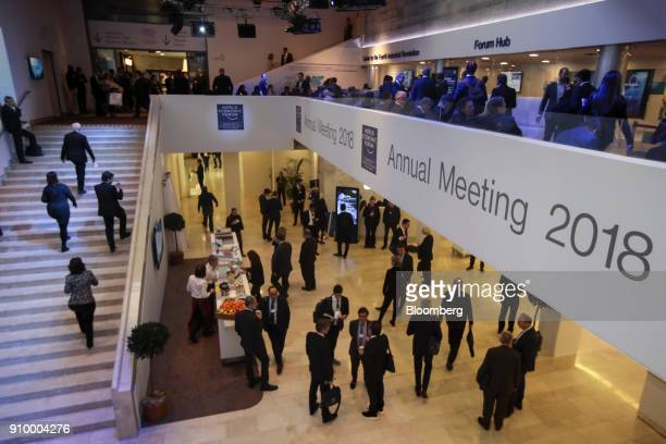 Attendees mingle in the halls of the Congress Center in between sessions on day three of the World Economic Forum in Davos Switzerland on Thursday...