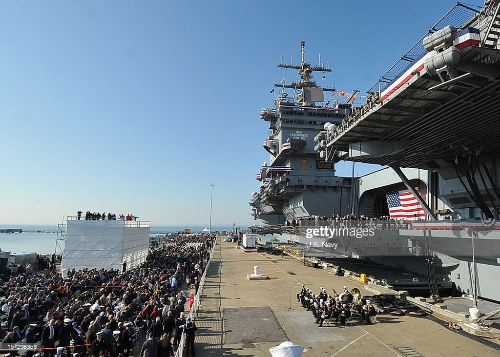Attendees observe the inactivation ceremony of the aircraft carrier USS Enterprise (CVN 65) on December 1, 2012 in Norfolk Virginia.. Enterprise was commissioned in 1961 and is scheduled to celebrate her inactivation after 51 years of service.