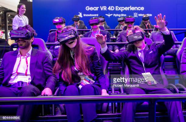 Attendees of Mobile World Congress 2018 are seen enjoying a Samsung VR 4D experience on February 26 2018 in Barcelona Spain Mobile World Congress...