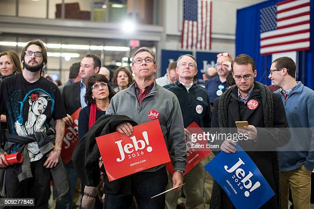 Attendees of Republican presidential candidate Jeb Bush's election night party watch a large projection screen for poll results at Manchester...