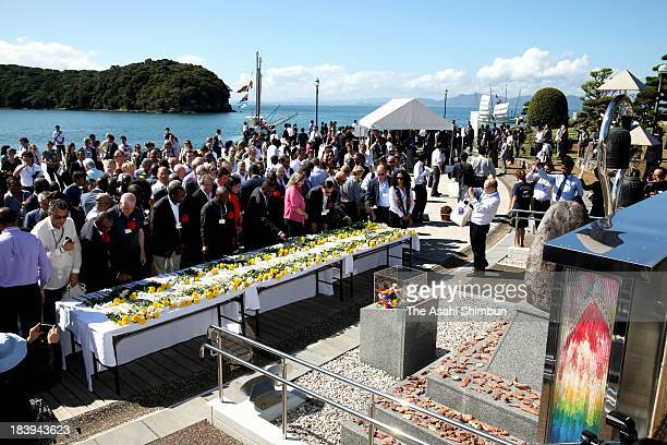 Attendees of the diplomatic conference of the Plenipotentiaries on the Minamata Convention on Mercury offer flowers on October 9 2013 in Minamata...