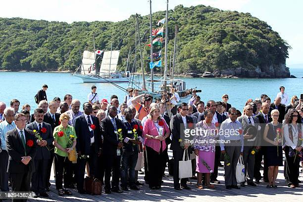 Attendees of the diplomatic conference of the Plenipotentiaries on the Minamata Convention on Mercury observe a minute of silence on October 9 2013...