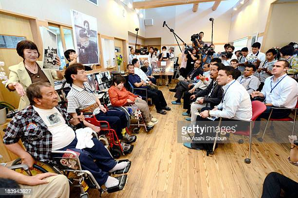 Attendees of the diplomatic conference of the Plenipotentiaries on the Minamata Convention on Mercury meet congenital Minamata disease patients at...