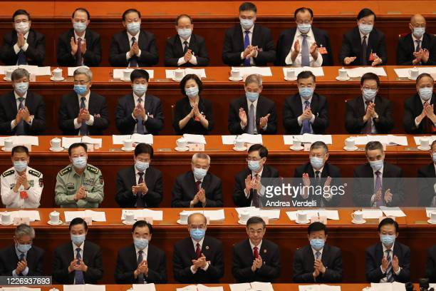 Attendees of the Second Plenary Session of the National People's Congress clap their hands during a speech on May 25 2020 at the Great Hall of The...