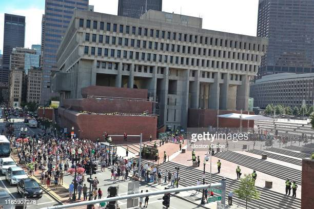 Attendees of the Straight Pride Parade gather at right at Boston City Hall as counterprotesters gather outside at left on Aug 31 2019 In dueling...
