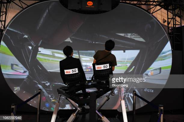 Attendees operate a Wonder Vision Techno Laboratory Co's Sphere 52 at the Combined Exhibition of Advanced Technologies Japan in Chiba Japan on Monday...
