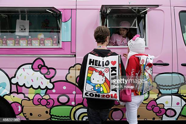 Attendees order food from a food truck outside of Hello Kitty Con October 31 2014 at The Geffen Contemporary at MOCA in Los Angeles California Some...