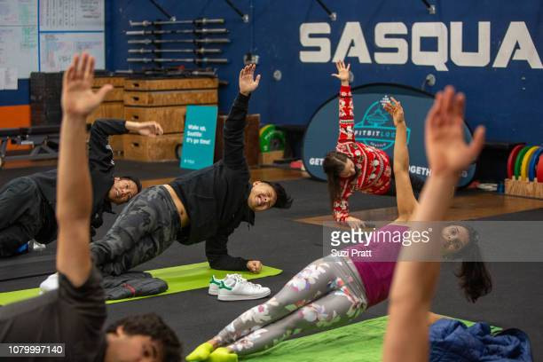 Attendees participate in a Fitbit Local event led by ambassadors Katie Kelly and Kevin Ng on December 09 2018 in Seattle Washington Fitbit Local is a...