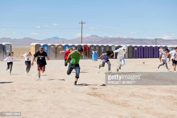 Attendees participate in a Naruto running race at Alienstock festival on the Extraterrestrial Highway in Rachel Nevada on September 20 2019