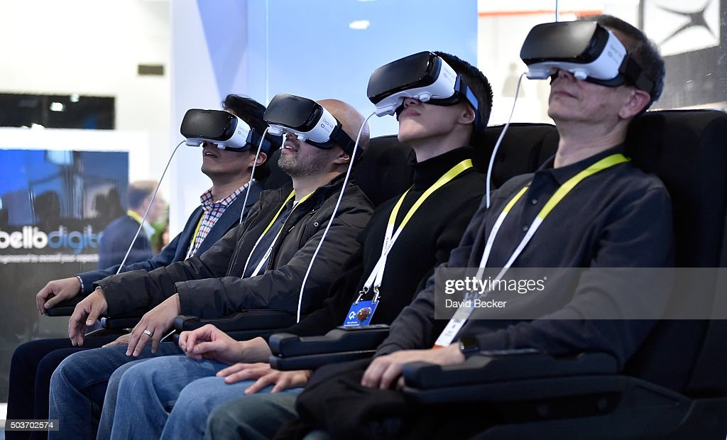 Attendees participate in a Samsung virtual reality experence at CES 2016 at the Las Vegas Convention Center on January 6, 2016 in Las Vegas, Nevada. CES, the world's largest annual consumer technology trade show, runs through January 9 and is expected to feature 3,600 exhibitors showing off their latest products and services to more than 150,000 attendees.