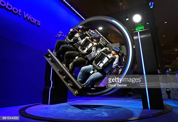 Attendees participate in a Samsung virtual reality ride at CES 2017 at the Las Vegas Convention Center on January 5 2017 in Las Vegas Nevada CES the...