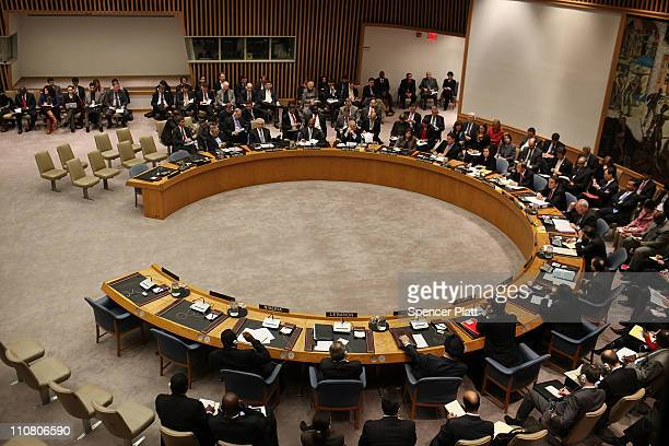 Attendees participate in a United Nations Security Council meeting where the situation in Libya was discussed on March 24 2011 at the United Nations...