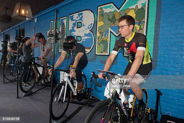 Attendees participate in a virtual reailty enhanced bicycle experience at the IBM installation at SXSW Interactive on March 13 2016 in Austin Texas