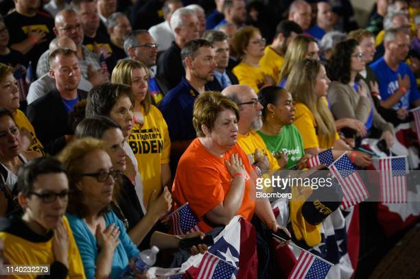 Attendees participate in the Pledge of Allegiance during a campaign stop for former US Vice President Joe Biden 2020 Democratic presidential...