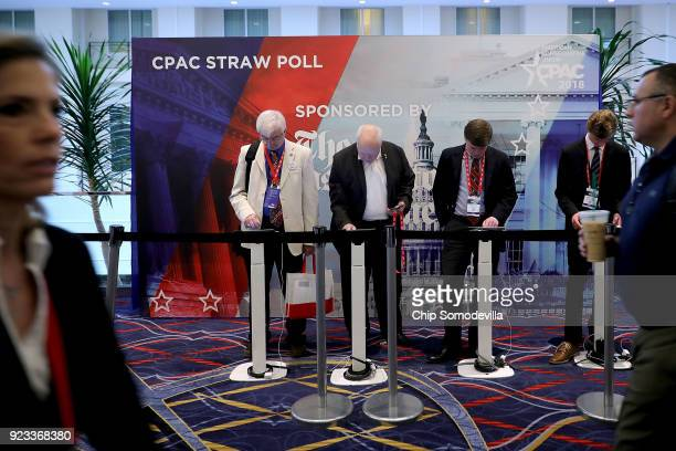 Attendees participate in the straw poll during the Conservative Political Action Conference at the Gaylord National Resort and Convention Center...