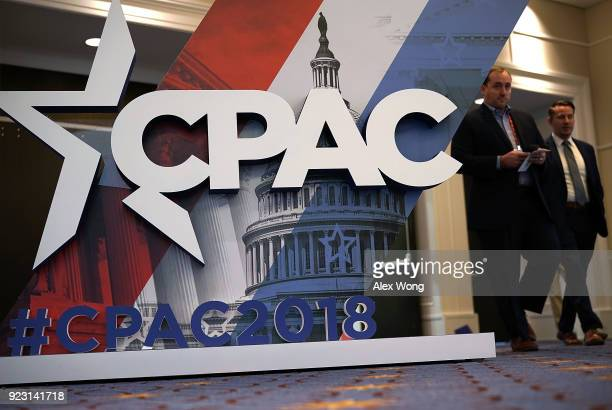 Attendees pass by a CPAC sign during CPAC 2018 February 22 2018 in National Harbor Maryland The American Conservative Union hosted its annual...