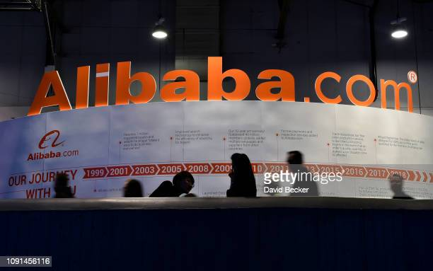 Attendees pass by an Alibabacom display at CES 2019 at the Las Vegas Convention Center on January 8 2019 in Las Vegas Nevada CES the world's largest...