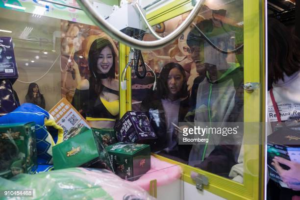 Attendees play a game of claw crane during the 2018 Taipei Game Show in Taipei Taiwan on Friday Jan 26 2018 The show runs through to Jan 29...