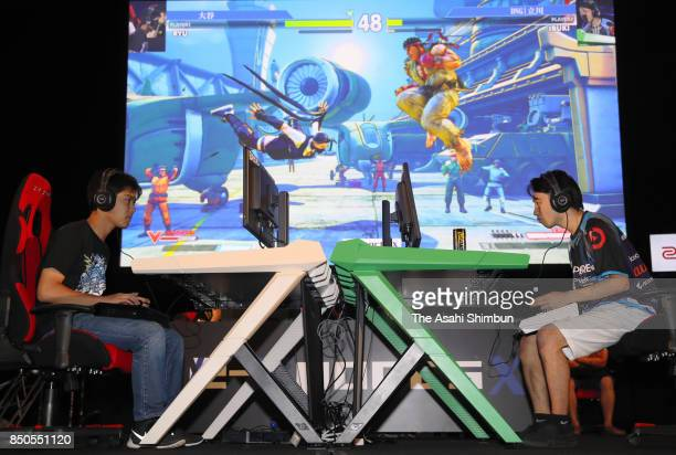 Attendees play a video game during an e-Sports event as a part of the Tokyo Game Show 2017 at Makuhari Messe on September 21, 2017 in Chiba, Japan.