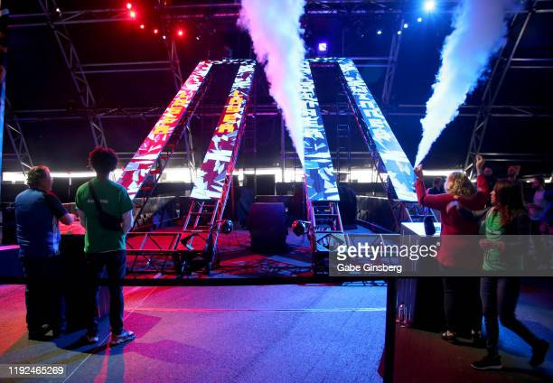 Attendees play Button Masher at the Intersect music festival at the Las Vegas Festival Grounds on December 6 2019 in Las Vegas Nevada