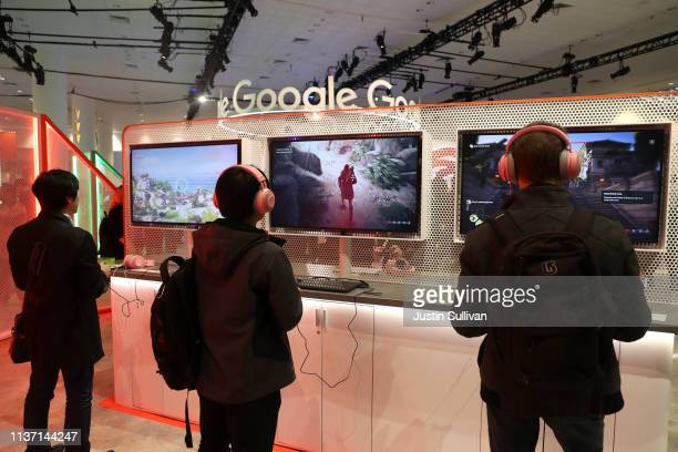 Attendees play games on the new Stadia gaming platform at the Google booth at the 2019 GDC Game Developers Conference on March 20 2019 in San...