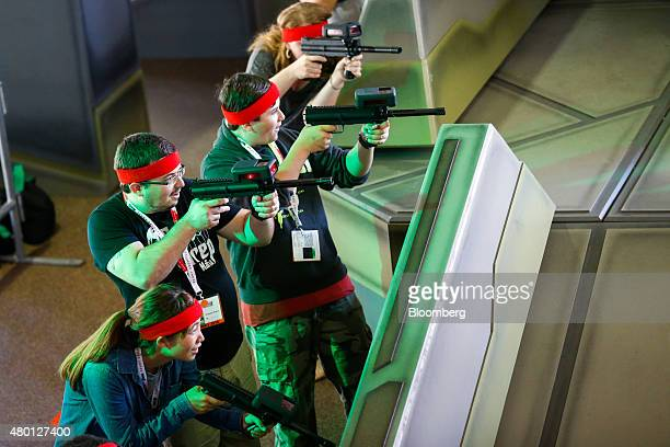 Attendees play laser tag during a simulation of TakeTwo Interactive Software Inc's Battleborn video game at the ComicCon International convention in...