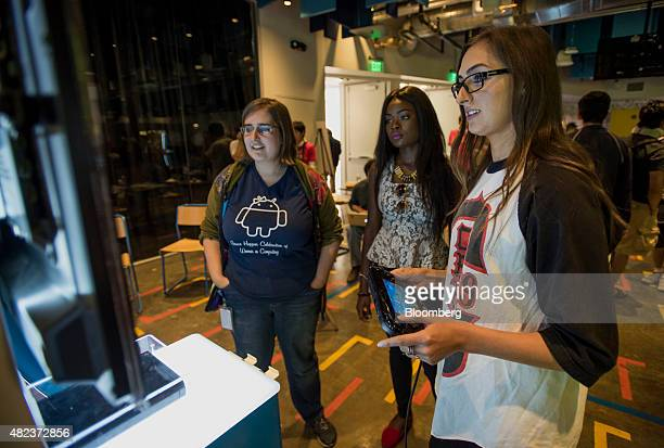Attendees play Nintendo Co's Super Mario Maker video game during a hackathon at the Facebook Inc headquarters in Menlo Park California US on...