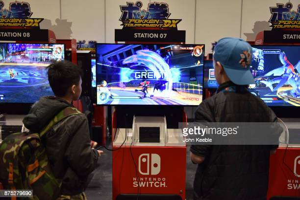 Attendees play Pokkén Tournament DX on the Nintendo Switch at the Pokemon European International Championships at ExCel on November 17 2017 in London...