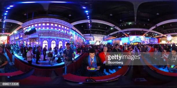 Attendees play 'Super Mario Odyssey' on the Nintendo Co Switch video game console at the company's booth during the E3 Electronic Entertainment Expo...