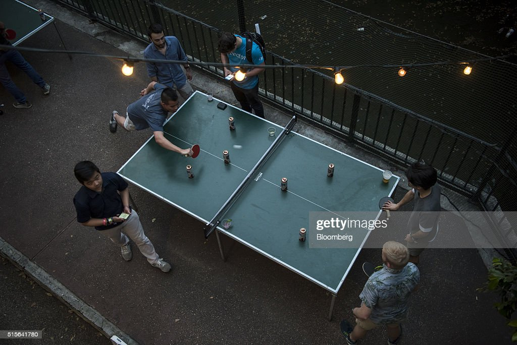 Attendees play table tennis at a private party during the South By Southwest (SXSW) Interactive Festival at the Austin Convention Center in Austin, Texas, U.S., on Monday, March 14, 2016. The SXSW Interactive Festival features presentations and panels from the brightest minds in emerging technology, scores of networking events hosted by industry leaders and a lineup of special programs showcasing new websites, video games, and startup ideas. Photographer: David Paul Morris/Bloomberg via Getty Images