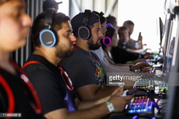 Attendees play the Apex Legends video game during an Electronic Arts Inc event ahead of the E3 Electronic Entertainment Expo in Los Angeles...