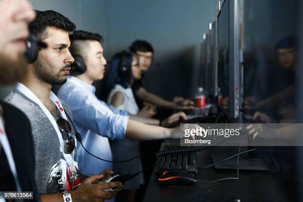 Attendees play the Battlefield V video game during an Electronic Arts Inc Play event ahead of the E3 Electronic Entertainment Expo in Los Angeles...